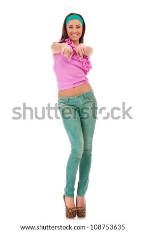 hot rock and roll woman wearing high heels shoes, with windy hair, holding her electric guitar on the ground, on white background - stock photo