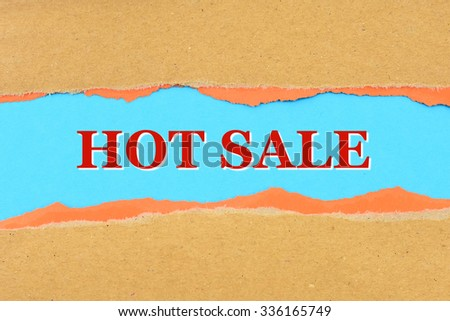 HOT SALE on a torn paper - stock photo