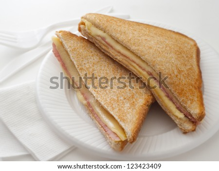 Hot sandwich with ham cheese for breakfast - stock photo