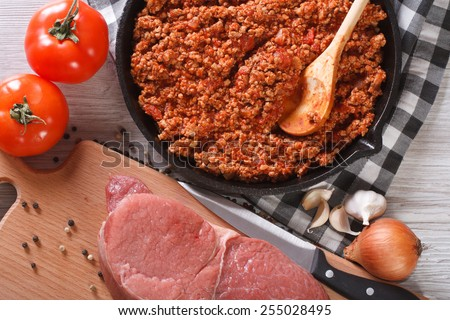 hot sauce bolognese and fresh ingredients close up. horizontal view from above - stock photo