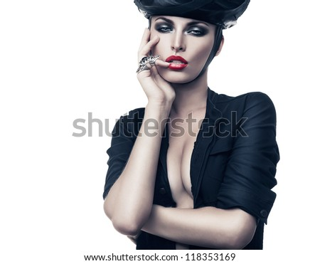 hot sexy imperious woman in black with ring on white background - stock photo