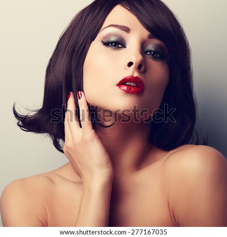 Hot sexy makeup model with short black hair style and red lipstick. Vintage closeup portrait - stock photo