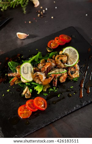Hot Shrimp Appetizers with Herbs and Tomato - stock photo