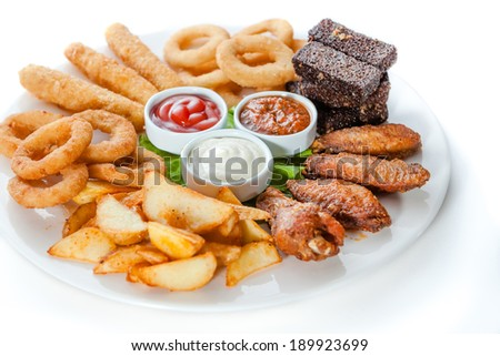 hot snacks. chicken wings, cheese, croutons and sauce - stock photo