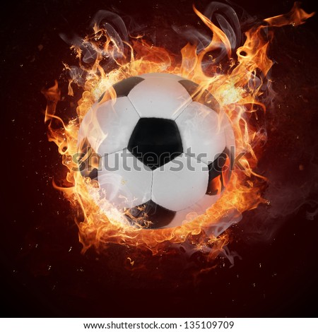 Hot soccer ball in fires flame - stock photo