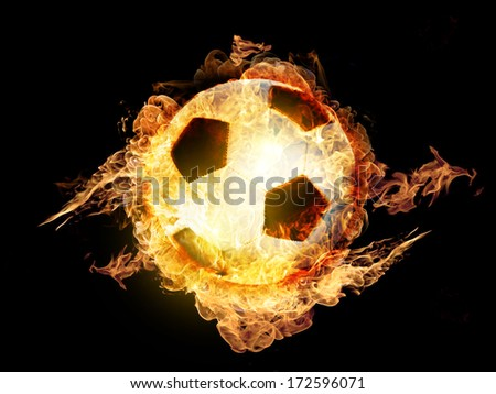 Hot soccer ball on the in flames - stock photo