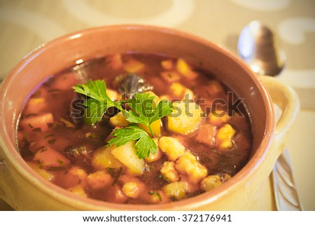 Hot soup (Goulash) with vegetables , shallow depth of field - stock photo