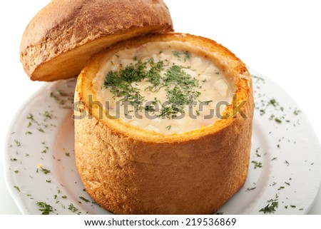 Hot Soup in a Loaf with Dill - stock photo