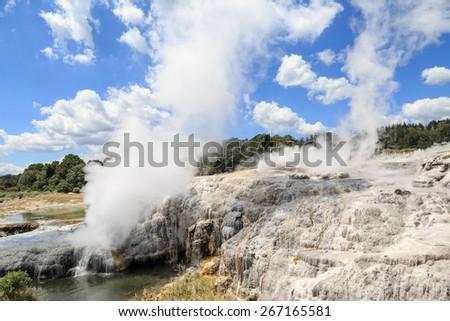 Hot sources and geysirs steaming in Te Puia a park with geothermal activity near Rotorua, New Zealand - stock photo