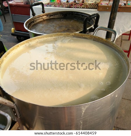 Hot soy milk, Black sesame seeds soy milk in big pot at the market