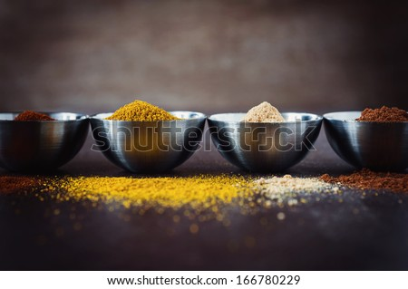 hot spices on rustic background - stock photo