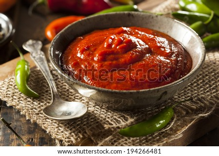 Hot Spicy Red Sriracha Sauce in a Bowl - stock photo