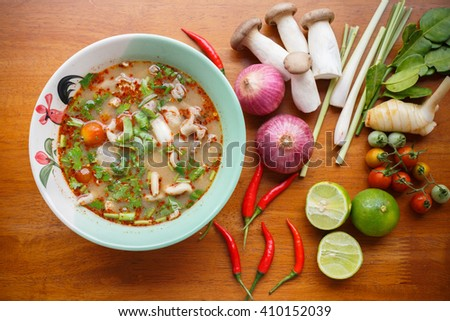 Hot & spicy soup with pork and chilli paste Ingredient on wooden table. - stock photo