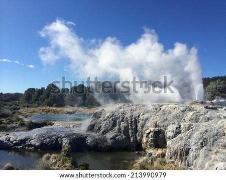 Hot spring erupts with a cloud formation in Te Puia New Zealand