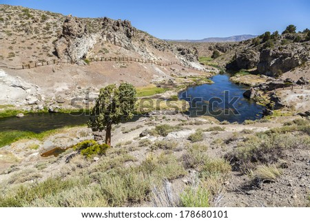 hot springs at hot creek geological site near mammoth - stock photo