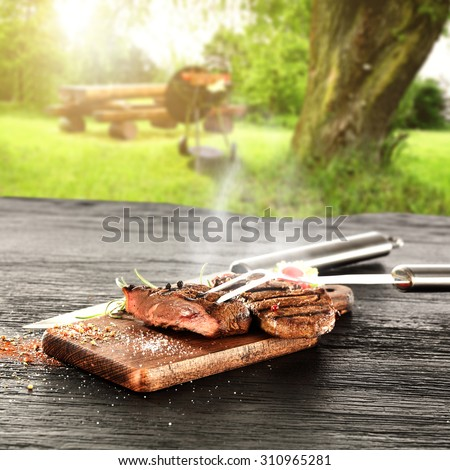 hot steak and sunny day in garden  - stock photo