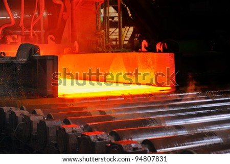 hot steel on conveyor - stock photo
