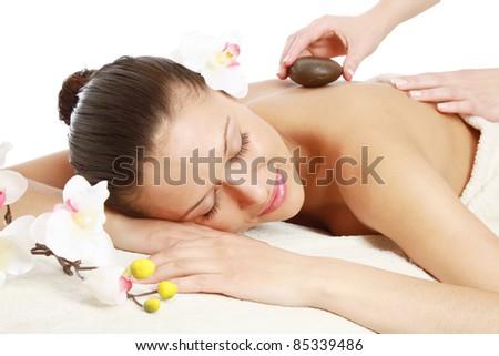 Hot stone massage at spa salon - stock photo