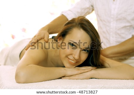 Hot stone massaging with hand
