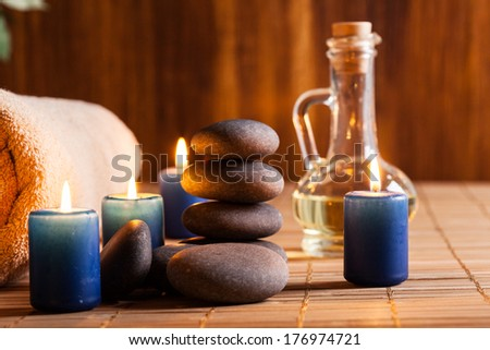 Hot stones essential oil and candles. Dark tone