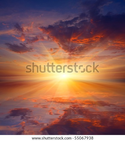 Hot sunset in nice sky over water - stock photo