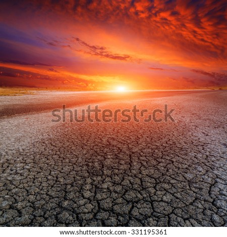 Hot sunset over dead earth - stock photo