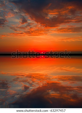 hot sunset over lake