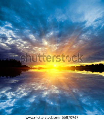 hot sunset over water - stock photo