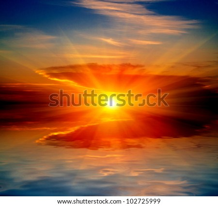 hot sunset over water in lake