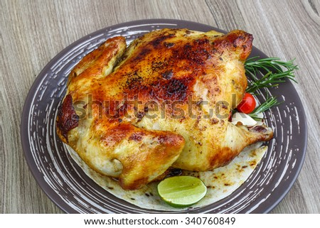 Hot tasty Grilled chicken with rosemary, lime and tomato