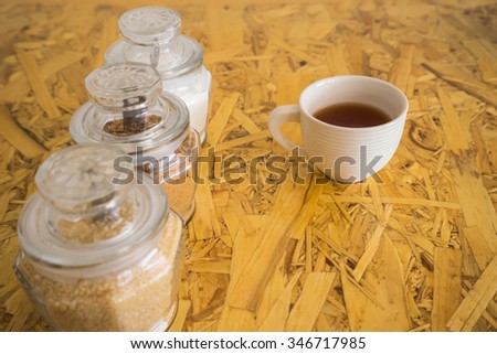 hot tea and ingredient on the wooden background - stock photo