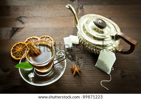 hot tea and old tea pot - stock photo
