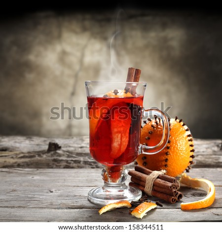 hot tea and orange fruit on sill  - stock photo