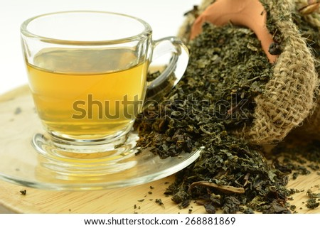 Hot tea in a glass and Dry tea leaves  - stock photo