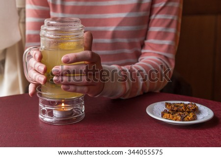 Hot tea in a glass cup - stock photo