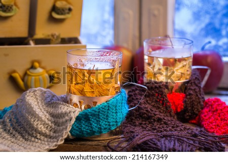 Hot tea in a winter evening for two - stock photo
