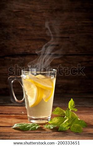 hot tea on wooden table - stock photo