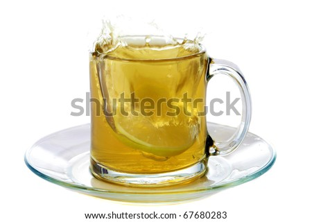 hot tea splashes as a lemon slice or sugar cube is dropped into it making a mess and splashing all over