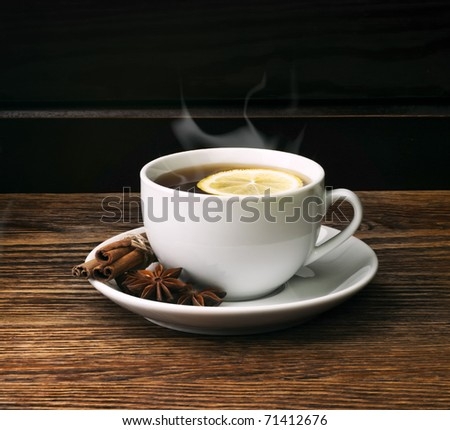 hot tea with lemon and evaporation - stock photo