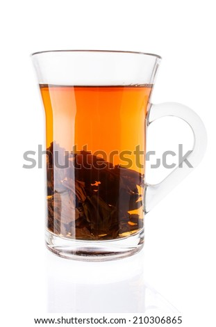 Hot Tea with Tea Leaves in Glass Cup Isolated on White