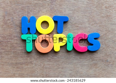 Hot Topic on wooden backgound - stock photo