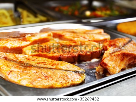 Hot tray with grilled salmon. Shallow DOF!