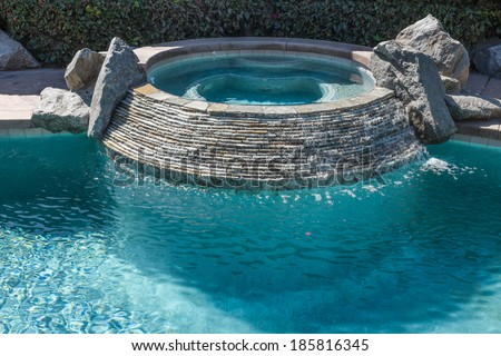 Hot Tub in Swimming Pool - stock photo