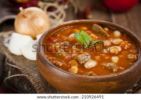 Hot turkish bean stew with a tasty tomato sauce. - stock photo
