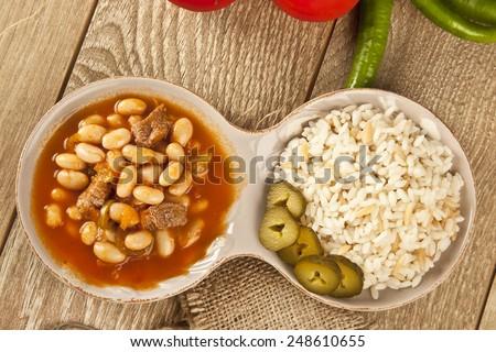 Hot turkish bean stew with a tasty tomato sauce and rice turkish pilav  - stock photo
