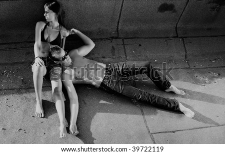 Hot  urban couple relaxing - stock photo