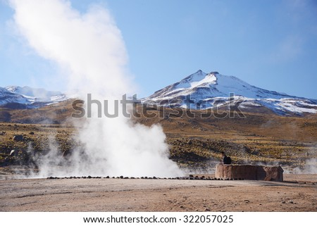 hot vapor plume from El Tatio geyser in northern chile - stock photo