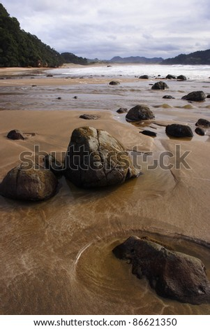 Hot water beach on the Coromandel peninsula on the North island of New Zealand - stock photo