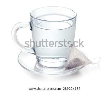 hot water in glass and teabag on white background