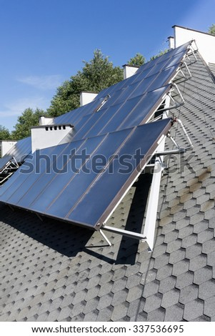 Hot water solar heating system - Solar panels on the roof - green energy, renewable energy, alternative energy - vertical image - nobody